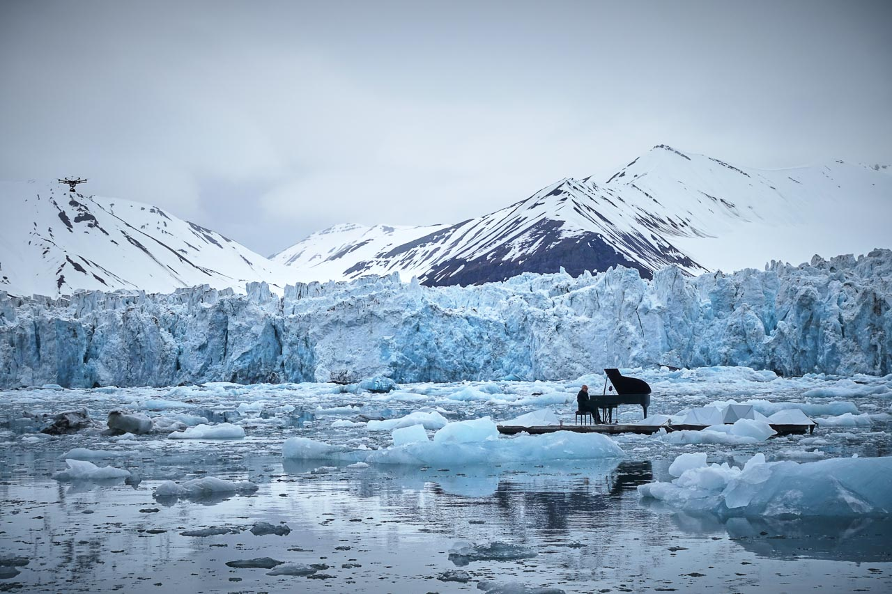 Ludovico Einaudi performs for Greenpeace in front of the Wahlenbergbreen glacier on a floating platform